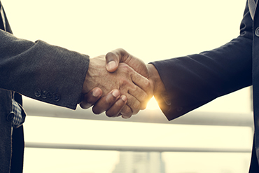 business handshake collaboration success concept PW2ZMBY